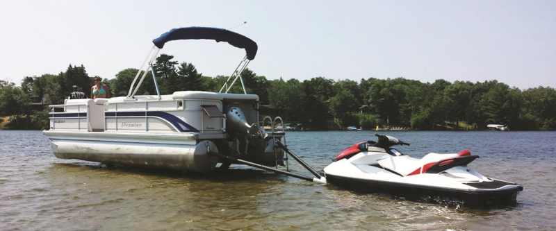 Towing a jet ski behind a boat