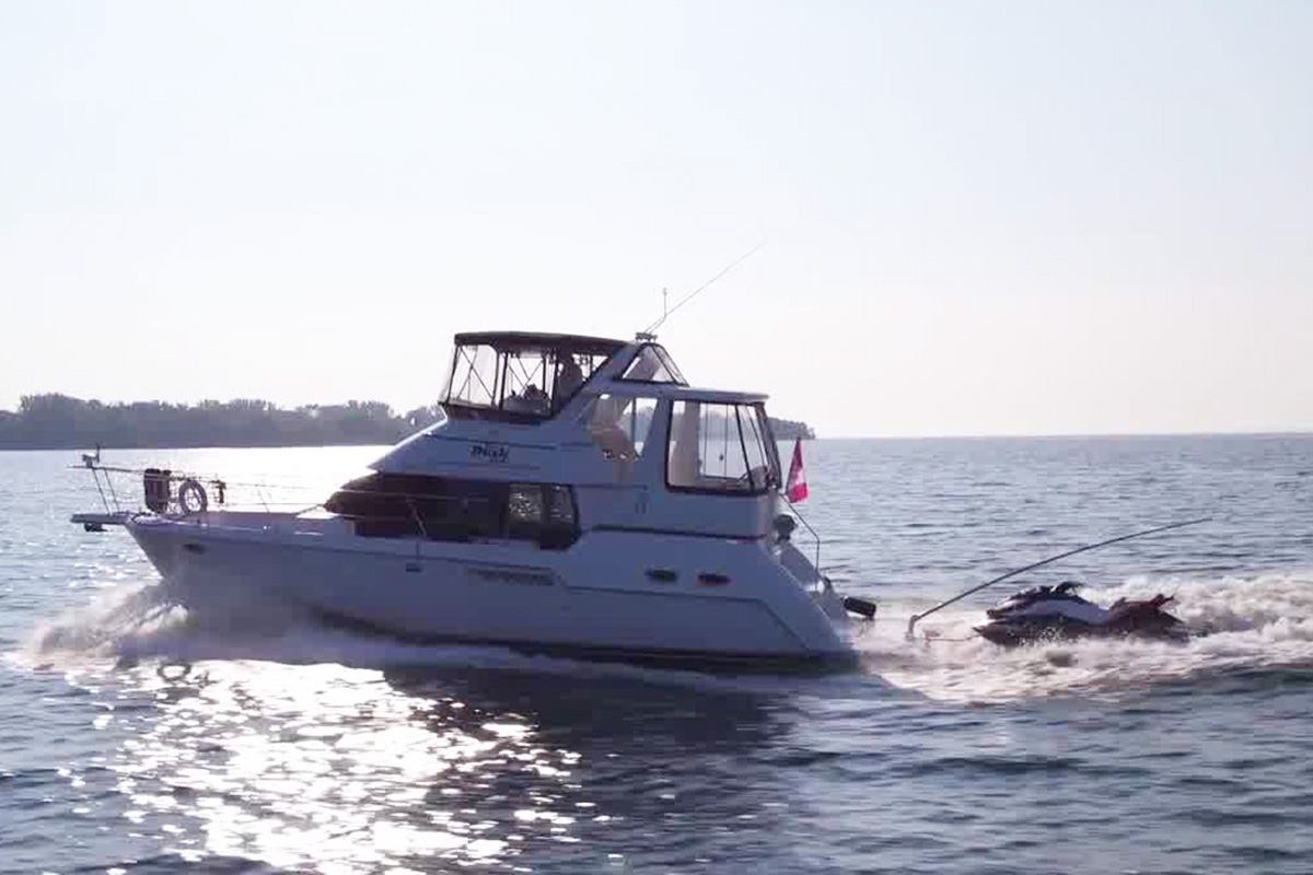 Towing a jet ski behind a boat with Magic Marine Tow